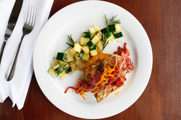 Chicken with Orange Piquillo Glaze with Polenta Manchego Cake and Sauteed Zucchini