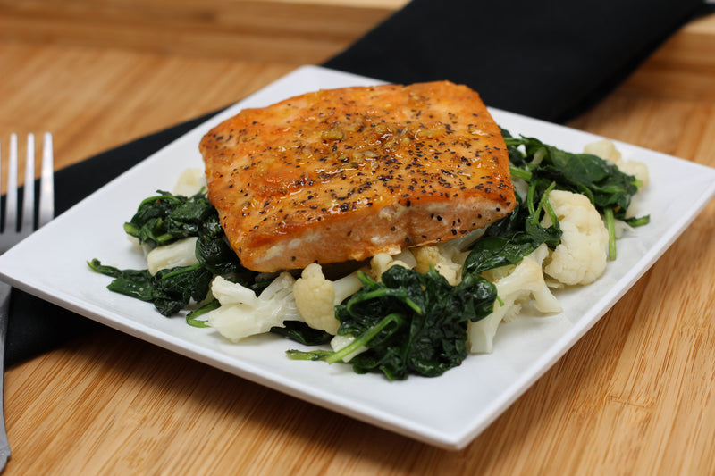 Keto Herbed Butter Salmon over Creamy Kale