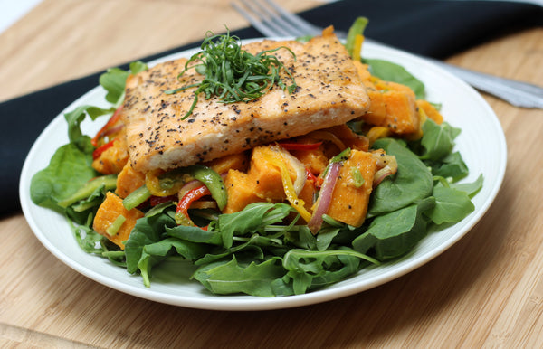 Paleo Honey Citrus Salmon with Sweet Potato Salad over Greens