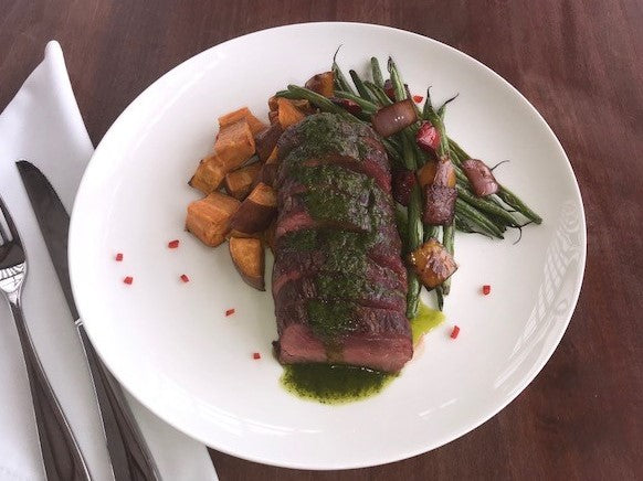 Steak with Smoky Cilantro Sauce with Roasted Sweet Potatoes and Sauteed Green Beans with Tri Color Peppers