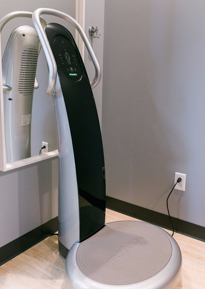 A whole-body vibration machine from Sonix, featured at Radiance Float + Wellness.