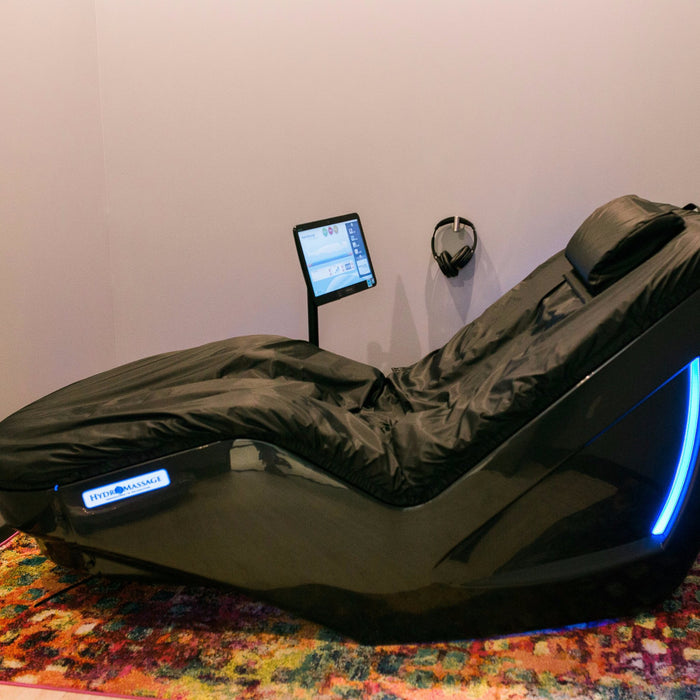 A hydromassage lounge chair displayed in the Radiance Float + Wellness facility.