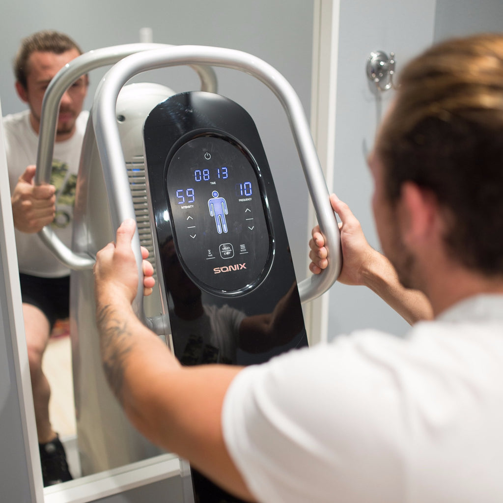 A customer exercising on the Sonix whole-body vibration machine.