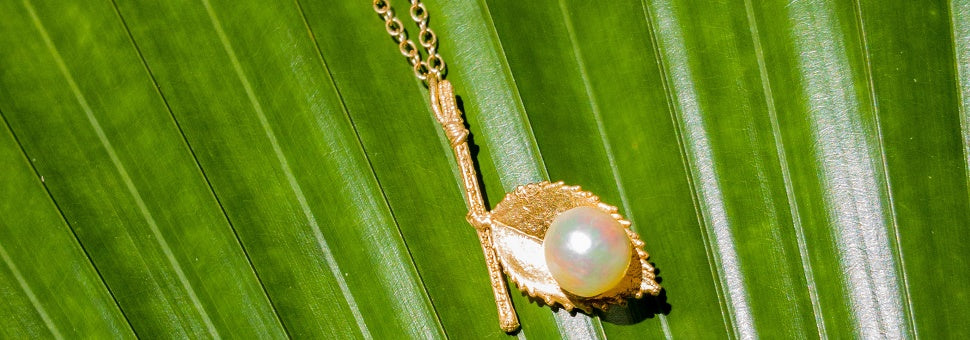 Gold Rose Leaf pendant with a natural pearl