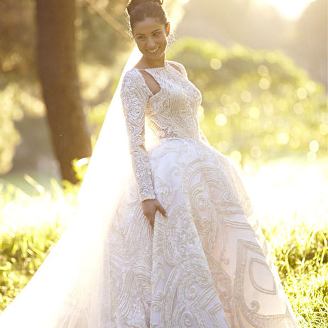 products/Unique_Style_Gorgeous_Applique_Beaded_Open_Back_Long_Sleeve_Ball_Gown_Wedding_Dresses_WD164.jpg