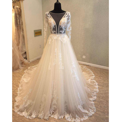 products/wedding_dress_59b35b82-206e-4802-af80-e69ccd04a169.jpg