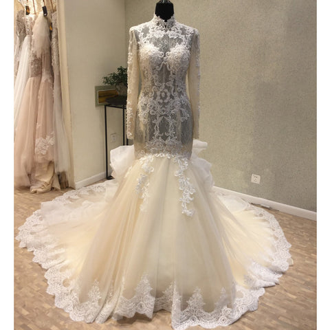 products/wedding_dress_cad57fdc-d066-4ca8-8f4e-c7da4144dbca.jpg
