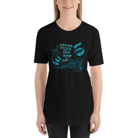 When you can't beat the odds, change the game. Six of Crows Quote Unisex Short Sleeved Shirt