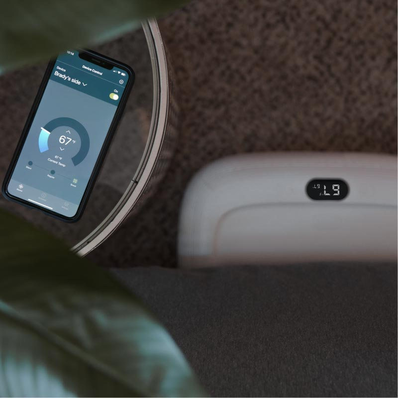OOLER Sleep System with mobile scheduling app on table.