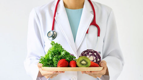 Dr. holding healthy food