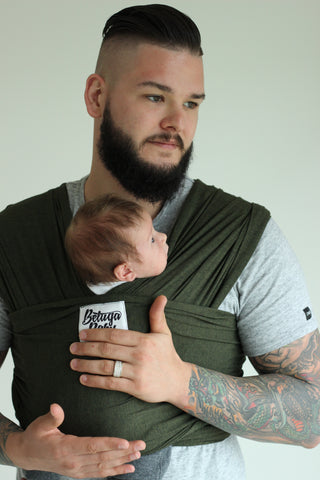 Bamboo baby carrier wrap. Hands-free baby holding.