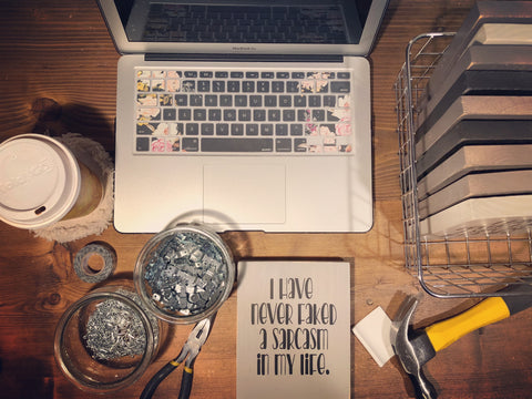 Workspace of Little Ditty Signs, snarky handmade signs by Diane Lanoue