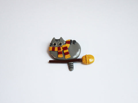 Cat on broom brooch - Adventacle