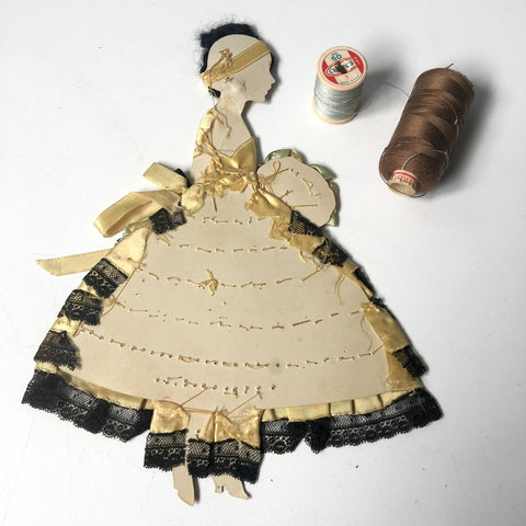 back of ribbon doll