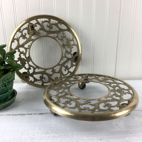 Brass rolling plant stands - a pair - 1970s vintage
