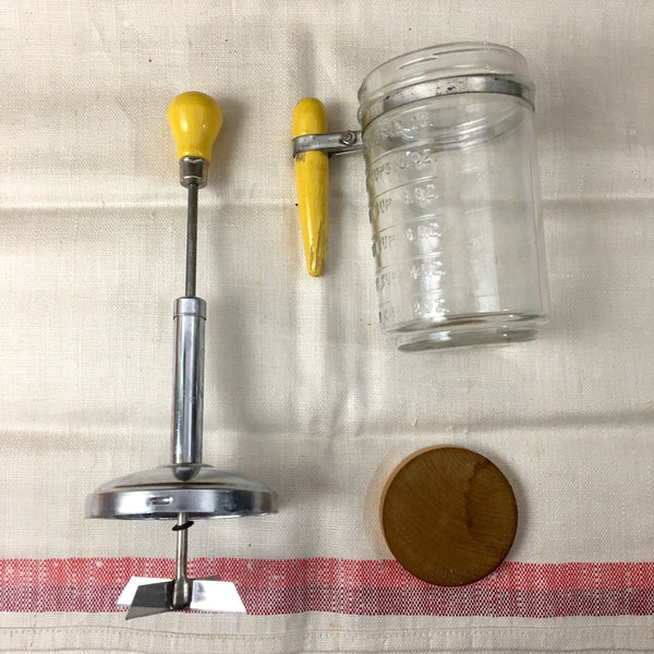 Hazel Atlas nut chopper - vintage glass with yellow wood handles - NextStage Vintage