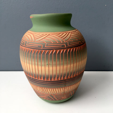 Navajo vase - terra-cotta with carved design - signed V. King