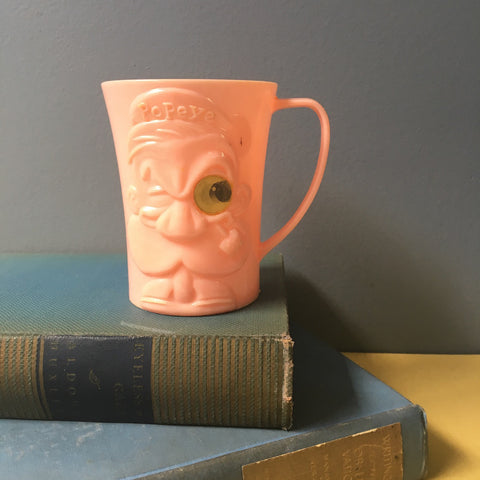Popeye the Sailor Man pink plastic mug with lenticular eye - 1950s novelty