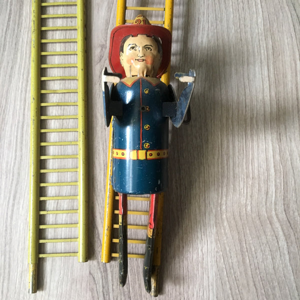 Louis Marx & Co. Smokey Joe climbing firefighter - vintage wind up toy