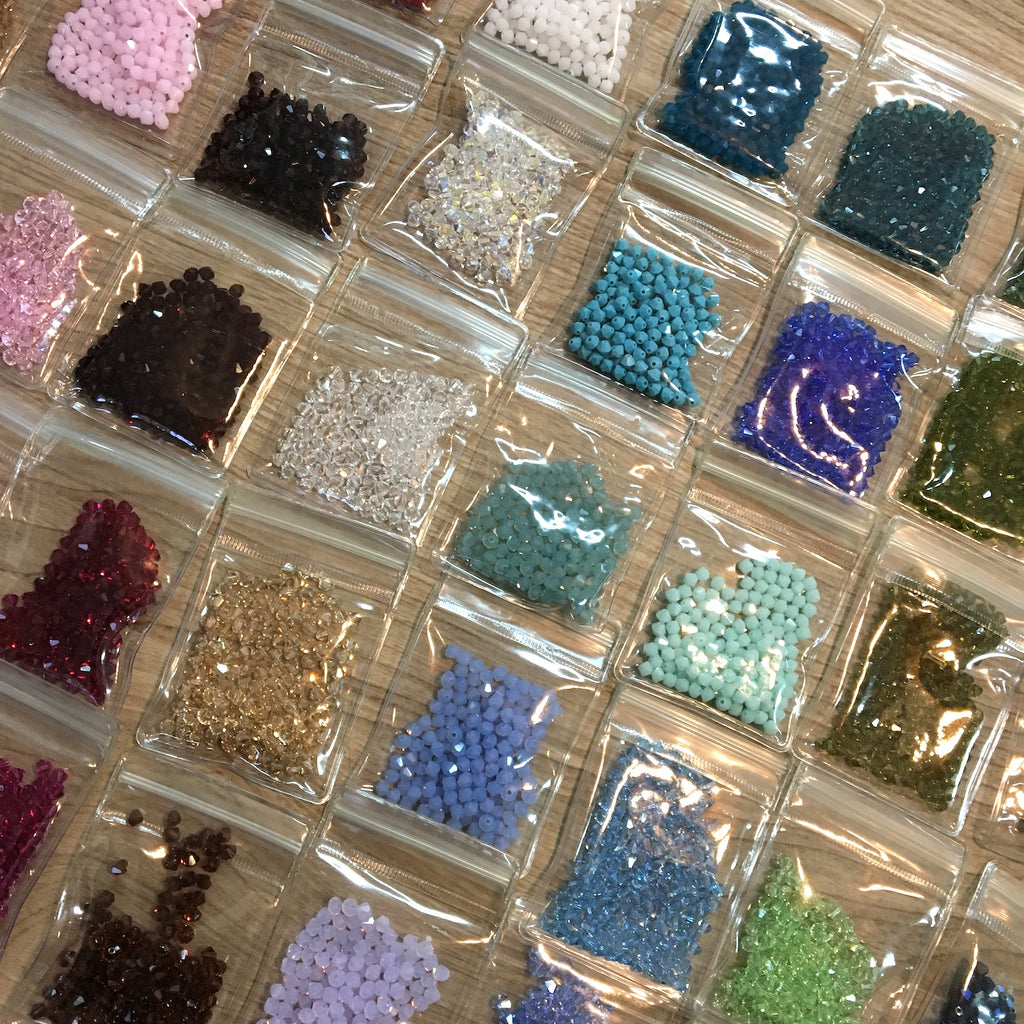 Swarovski Bicone Beads  #5328 4 mm - mixed colors - 7200 beads - lot 655 - NextStage Vintage