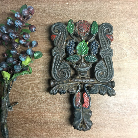 Wilton cast iron trivet - grapes in urn - No. 29 - chippy paint - 1950s vintage - NextStage Vintage