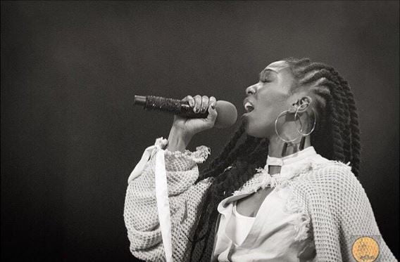"Brandy performs at Soulquarius wearing Steffi K's ""Sharina"" obsidian hoops"