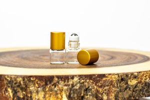 1 ml clear glass mini roller bottle with stainless steel roller and gold cap