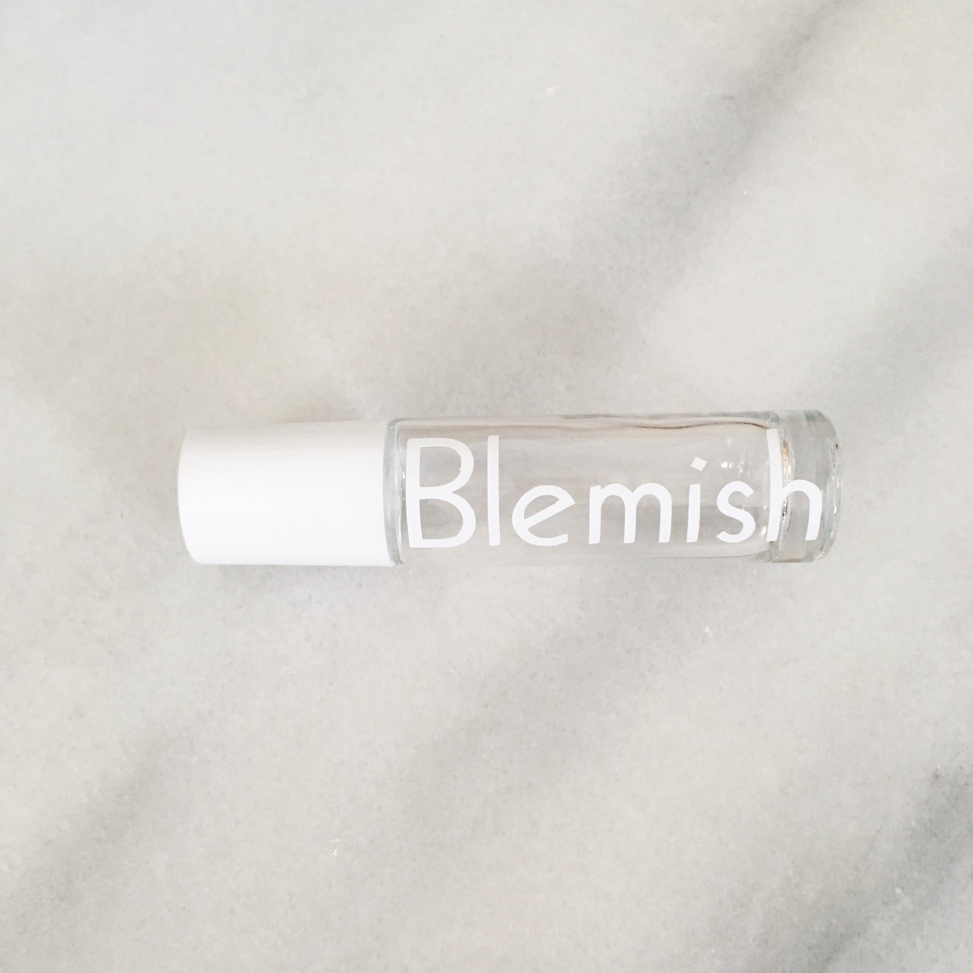 "White Vinyl Decal on clear 10 ml roller bottle ""Blemish"""