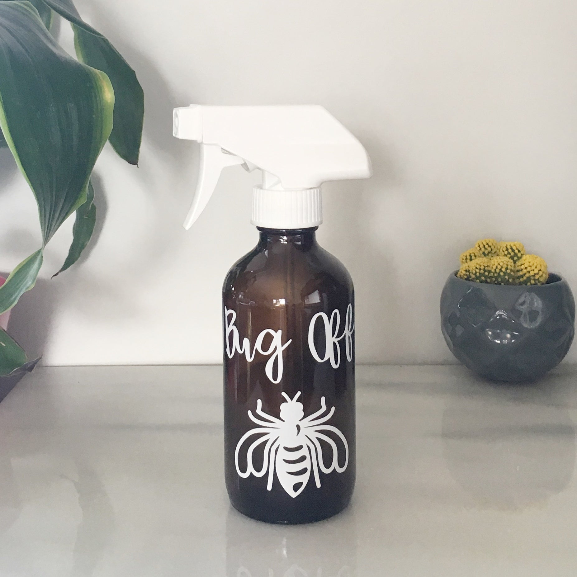"Vinyl Decal ""Bug Off"" on 8 oz. amber glass spray bottle"