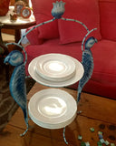 Los Loros plate stand by Crazy Daisy shown with plates at a buffet