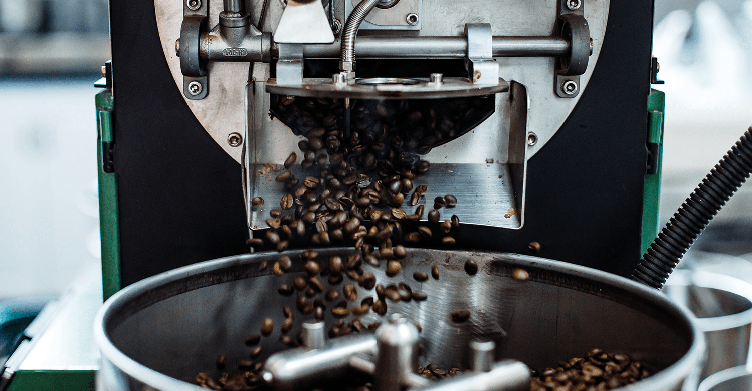 Beans being ejected out of of a coffee roaster