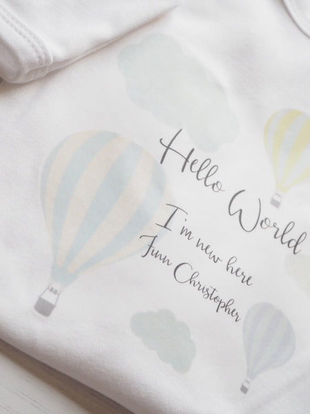 'Hello I'm New Here' Hot air Balloon and Clouds Personalised Sleepsuit