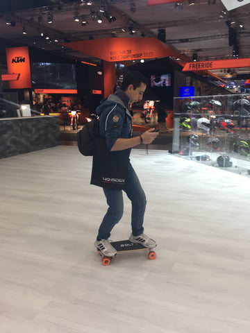 a person tries an electric skateboard for the first time