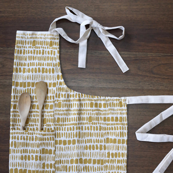 GOLD PRINT TASSELED APRON