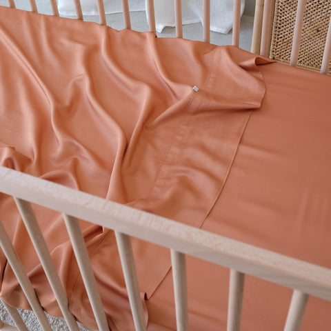 Mulberry Threads fitted cot sheet in rust
