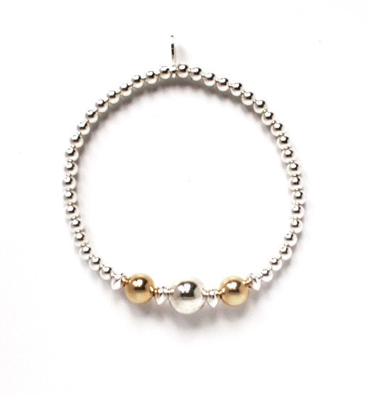 Sterling silver and yellow gold stacking bracelet.