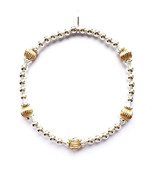 Sterling silver and a touch of yellow gold fancy beaded bracelet