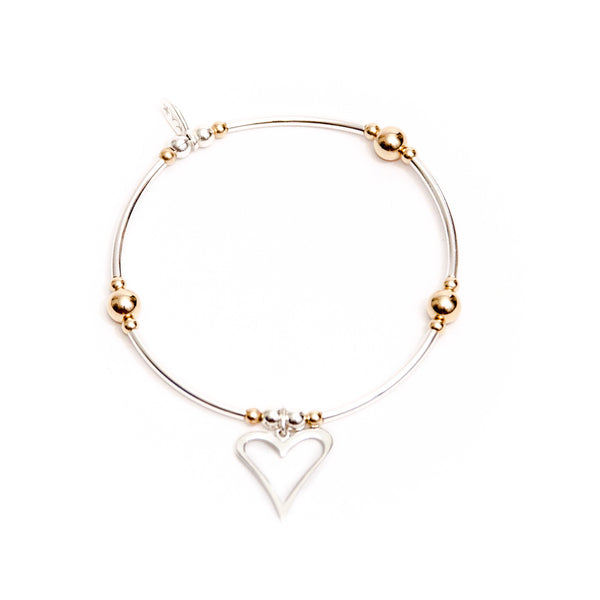 Sterling silver heart noodle bracelet with a touch of yellow gold