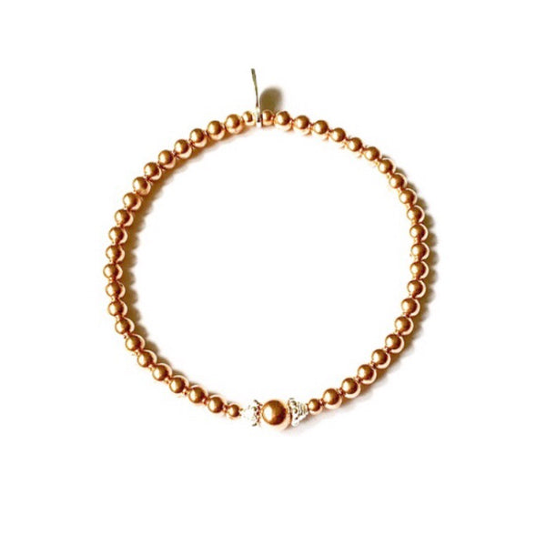Rose gold beaded bracelet with pretty sterling silver detail.