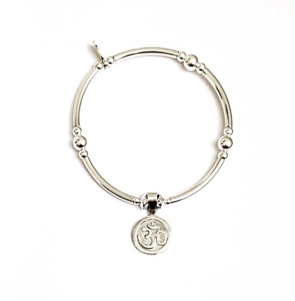Spiritual sterling silver noodle bracelet with an aum disk charm
