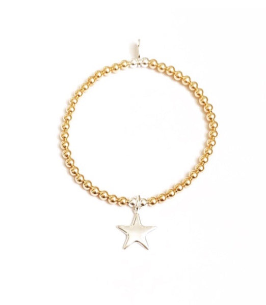 Yellow gold and sterling silver puffed star charm bracelet