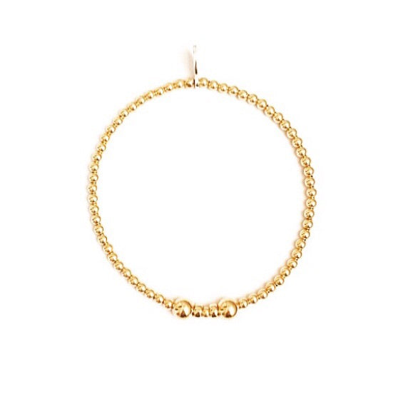 Dainty yellow gold beaded bracelet