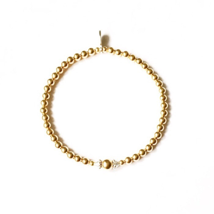 Yellow gold beaded bracelet with fancy sterling silver detail.