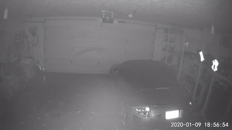 Wyze camera image from a dark garage