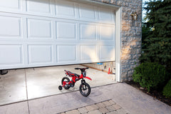 Garage door with bike in the way of it closing, the safe-t-beam system will reverse the door from closing.