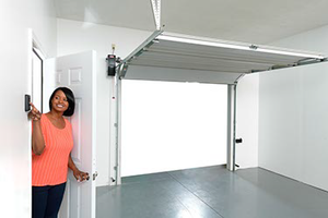 wall mount garage door opener quickly and quietly opens the garage door