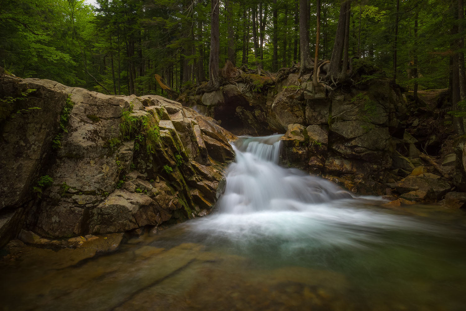 Landscape photo of a waterfall at The Basin - White Mountains, New Hampshire
