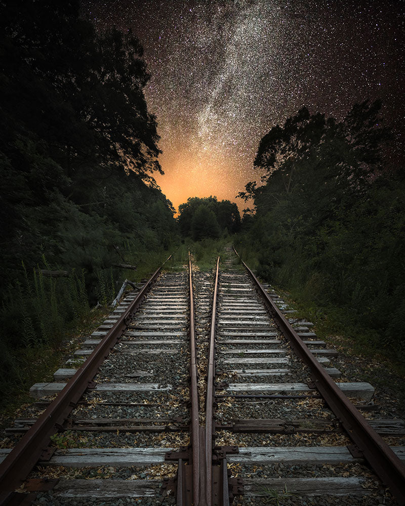 Landscape wall art photography of the Milky Way galaxy shining over an abandoned railroad in Massachusetts
