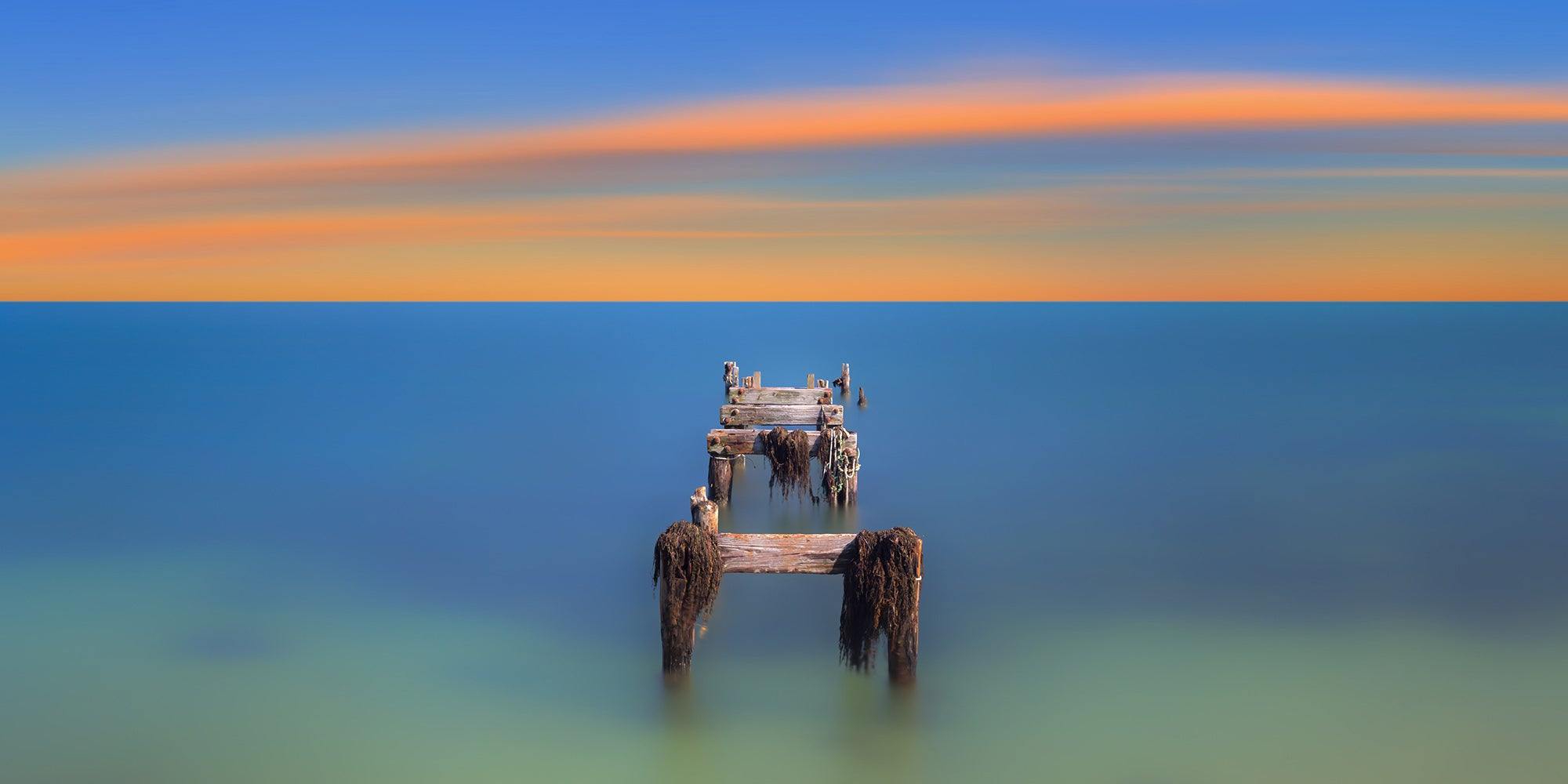 Landscape wall art photography of a decaying boat dock at sunset along a Cape Cod beach