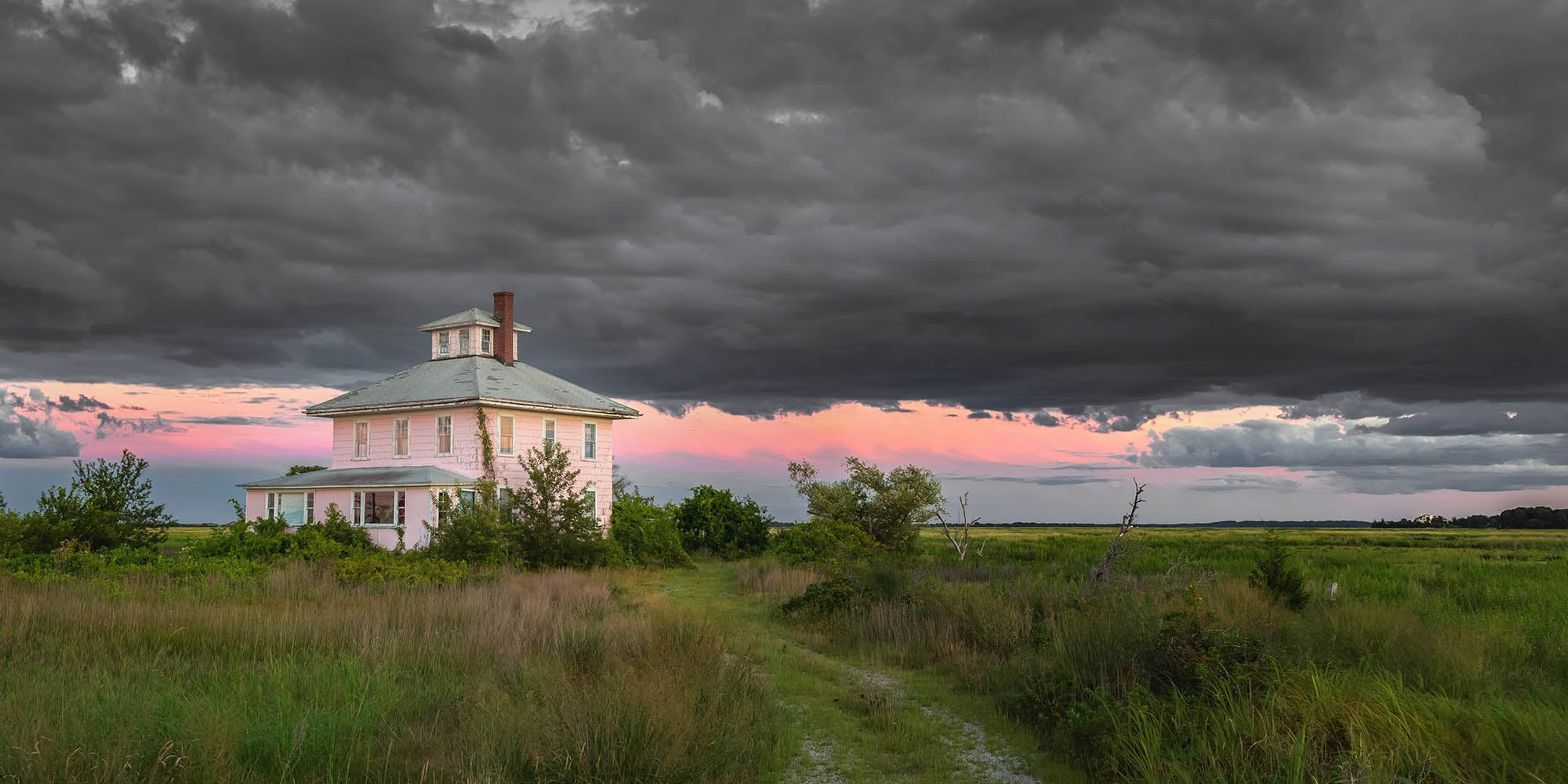 Landscape wall art photography of the iconic Plum Island pink house during a summer storm